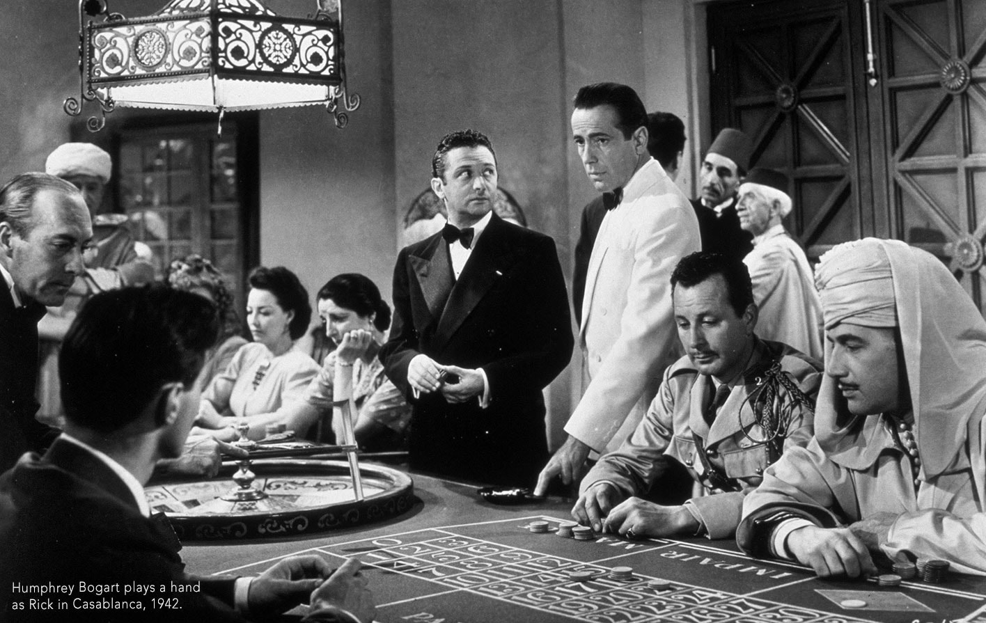 Humphrey Bogart plays a hand as Rick in Casablanca, 1942.