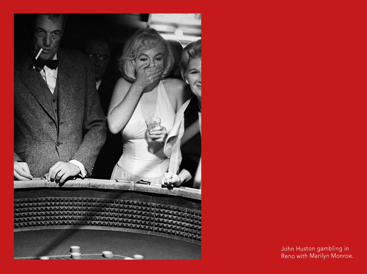 John Huston gambling in Reno with Marilyn Monroe.